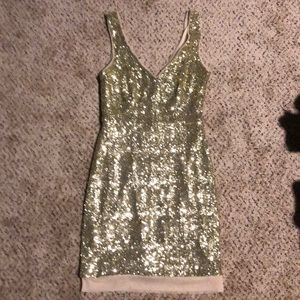 Gold sequin bodycon dress.